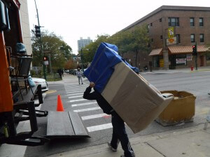 man carrying an item loading to the truck
