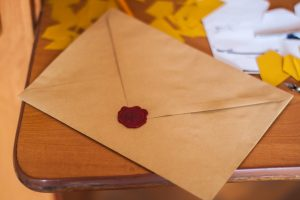 A brown envelope on the table.