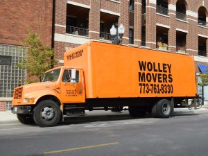 Orange Wolley Movers truck that our movers Wicker Park Chicago IL use.