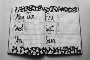 A notebook with the week days written in it, used to find the best time to move.