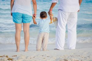 A family on the beach relocated by Bridgeport movers