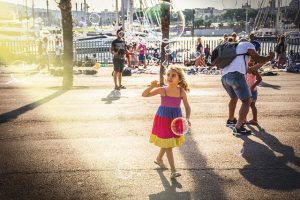 Girl chasing soap bubbles