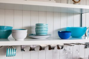 shelves on the wall with kitchen equipment