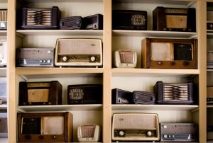 A shelf with old radios