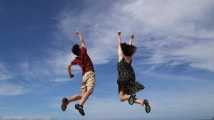 People jumping - you will feel this way after move with our North Park movers