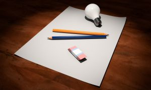 paper with pen and light bulb as representation for renovation ideas for your Chicago home
